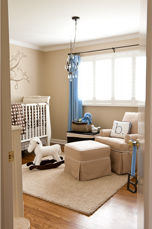 Here Is A Peek Into The Nursery From The Door. The Roomu0027s Calming Neutral  Palette Of Beige, Brown And White Is Accented With Pops Of Baby Boy Blue.