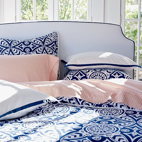 Blue and white a timeless look the bedding is beautifully paired