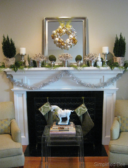 last year our holiday mantel was decorated asymmetrical with lots of