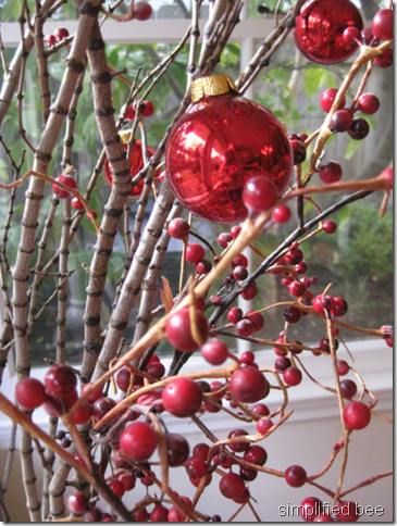 elf tabletop red glass ornaments twigs