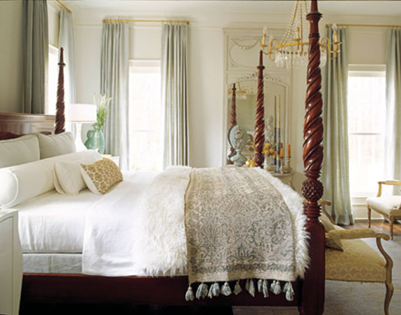 Beautiful While in residence Ireland used her own colorful suzani inspired fabrics to cover the chunky four poster bed The stunning long pillow is made of antique