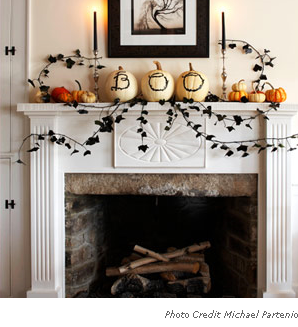 decorating your fireplace mantel is way to decorate the inside of your home for halloween this mantel with greeting from the grave is from delish