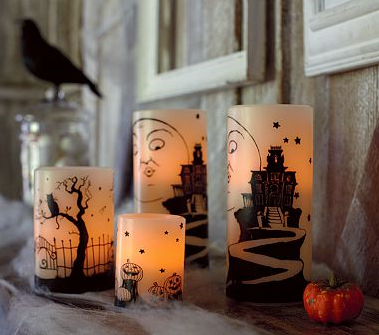 battery operated candles are a kid and pet friendly way to decorate your home for halloween these battery operated candles with eerie halloween landscapes