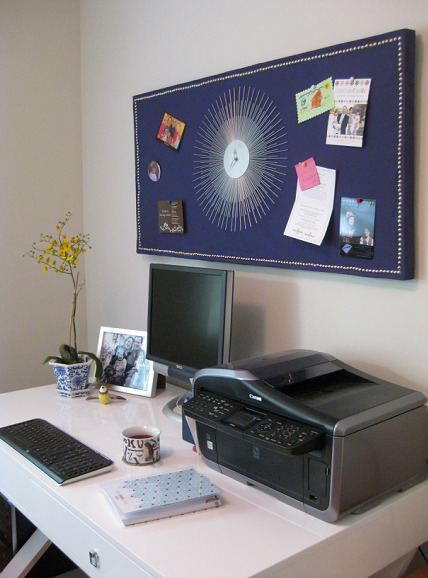 Home Office With White Lacquer Desk And Sunburst Clock