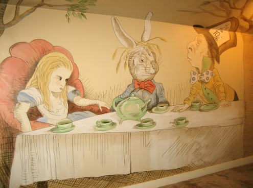 The caterpillar presides over a food station the down for Alice in wonderland mural