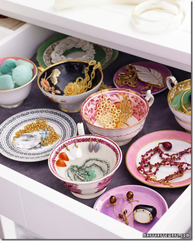 stylish drawer organizing china bowls cups