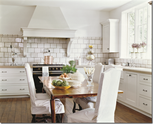 white kitchen with farm table designer
