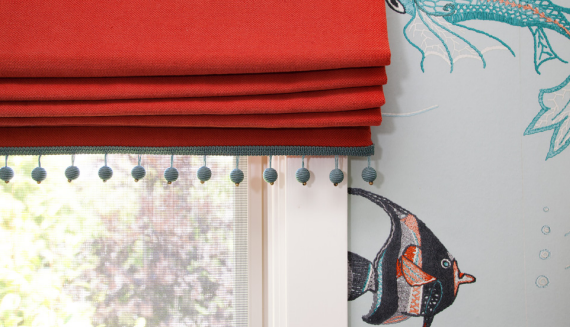 Red Roman Shade with Blue Pom Pom Trim