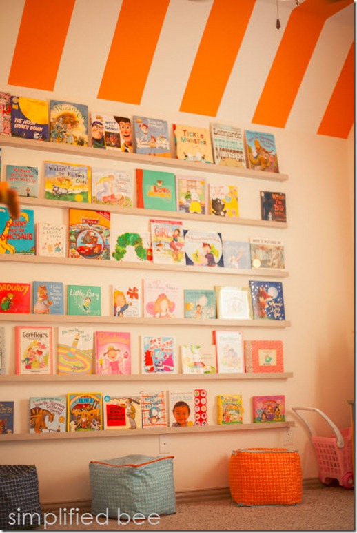 Playroom Book Wall and Orange Striped Ceiling by Simplified Bee