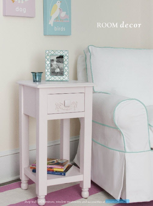 Tailored upholstery nursery glider in white