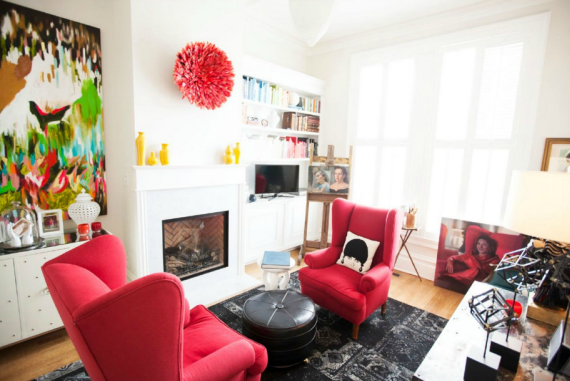 red chairs by fireplace