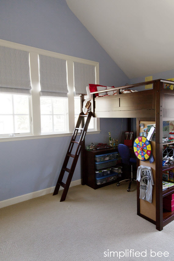 traditional boy's bedroom with high ceiling