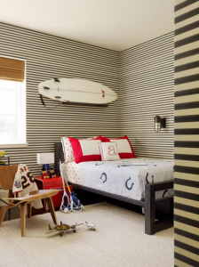 designer boys bedroom with surfboard