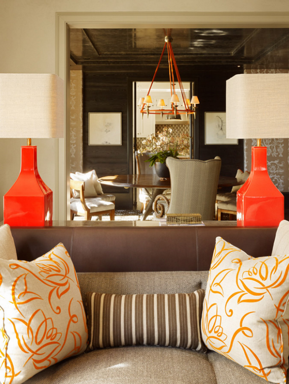 formal living room with orange lamps