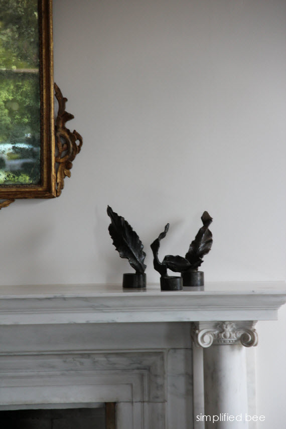 bronze feathers on marble mantel