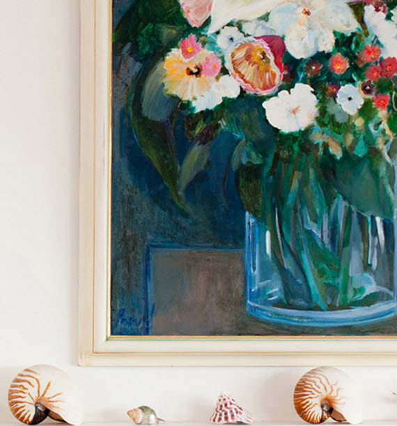 fireplace mantel with artwork and shells
