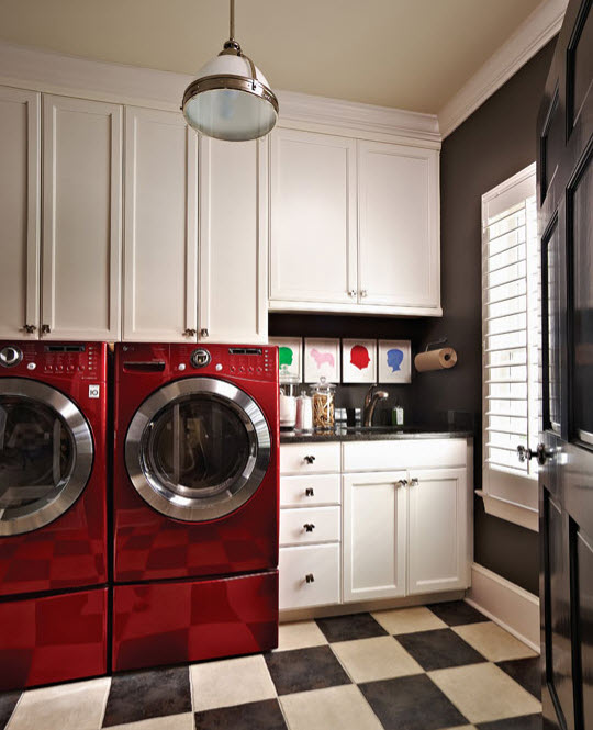 laundry room with red appliances