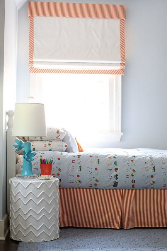 sweet boy's bedroom with orange accents