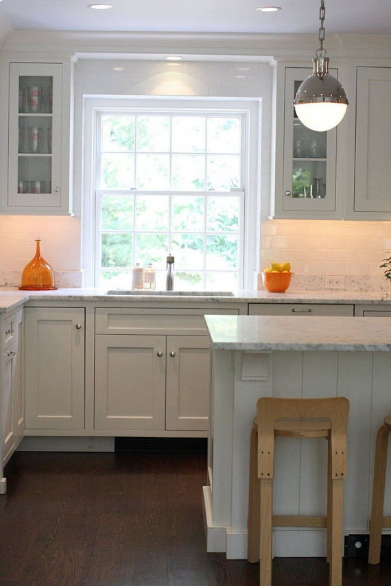 white designer kitchen with hicks pendant