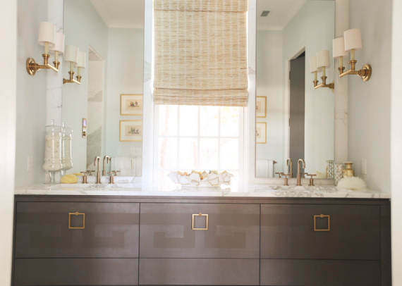 contemporary bathroom with brass fixtures, hardware and accents