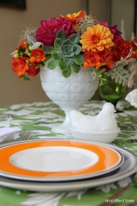 green and orange table setting // simplified bee