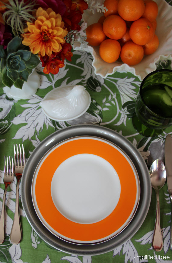orange dinnerware tablescape - Simplified Bee