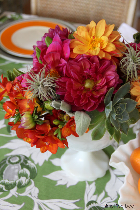 pink and orange floral arrangement with succulents