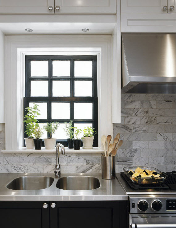 kitchen with stainless steel countertop and black window