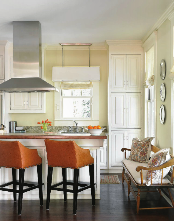 gourmet kitchen with orange barstools