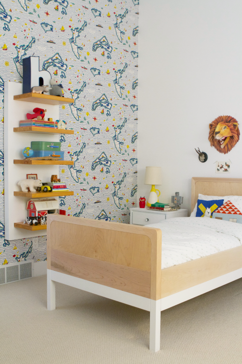 Boys toddler bedroom with map wallpaper