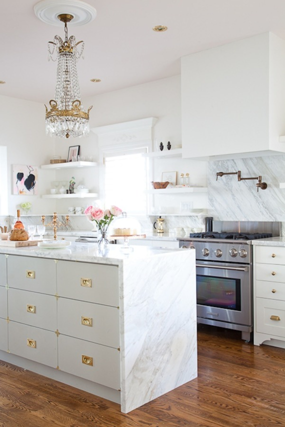 white kitchen with brass and marble
