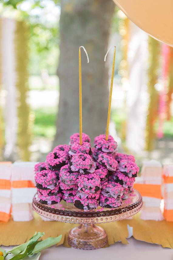 pink doughnut birthday cake