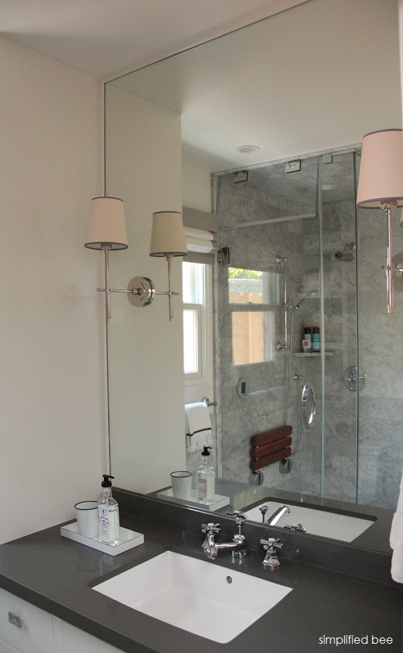 marble bathroom // mirror with scones // simplified bee design #bathrooms