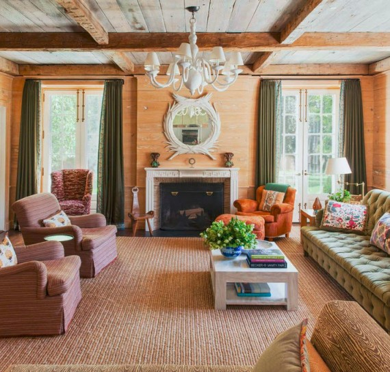family room in earth tones // beams and wood plank walls