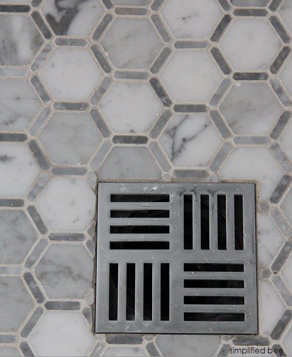 designer marble bathroom with square shower drain // cristin priest of simplified bee #bathrooms