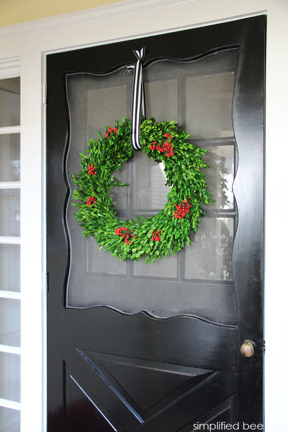 black front door with holiday boxwood wreath // simplified bee #holiday