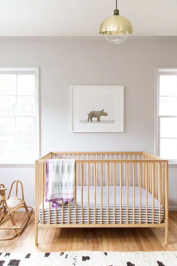 nursery design // baby rhino artwork // ikea crib
