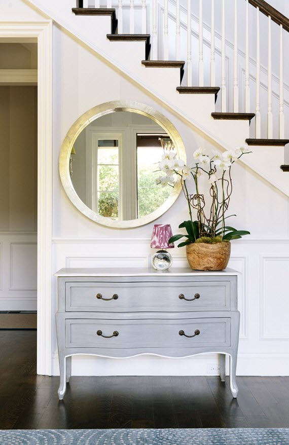 entry with stairway  // console & round mirror