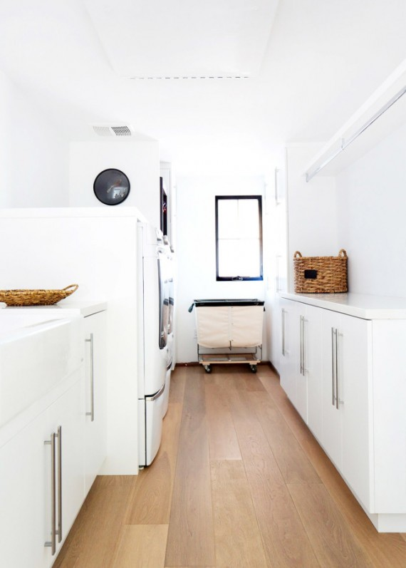 white laundry room with wooden floors // maggie pierson design