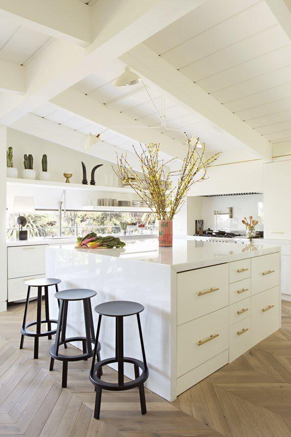 This Sleek Kitchen Island Design By Liz Hand Woods Balances Warm Wood Tones  With Limestone Waterfall Countertops. So Chic!