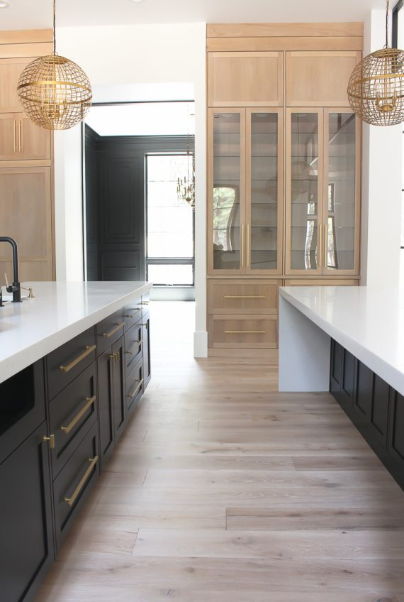 kitchen / white oak cabinets and double waterfall islands