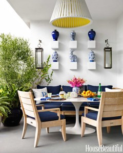 outdoor patio with saarinen table and blue sofa // Robert Passal