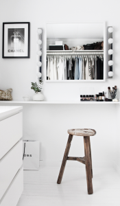 black and white walk-in-closet with vanity